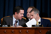 United States Representative Devin Nunes (Republican of California), Ranking Member, US House Permanent Select Committee on Intelligence (L) talks with Republican legal counsel Steve Castor (R) while listening to the testimony from Former US Special Representative for Ukraine Kurt Volker and former Senior Director for Europe and Russia at the National Security Council Tim Morrison during the House Permanent Select Committee on Intelligence public hearing on the impeachment inquiry into US President Donald J. Trump, on Capitol Hill in Washington, DC, USA, 19 November 2019. The impeachment inquiry is being led by three congressional committees and was launched following a whistleblower's complaint that alleges US President Donald J. Trump requested help from the President of Ukraine to investigate a political rival, Joe Biden and his son Hunter Biden.<br /> Credit: Shawn Thew / Pool via CNP