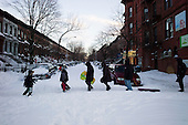 Brooklyn, New York<br /> December 27, 2010<br /> <br /> Snow blizzard on the East Coast. People move down 7th Avenue as cross streets remain un-plowed after the first full day.