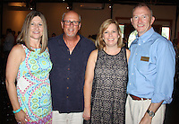 NWA Democrat-Gazette/CARIN SCHOPPMEYER Lori and Steve Collins (from left) and Kathie and Peter Hamilton help support Youth Bridge on June 17.