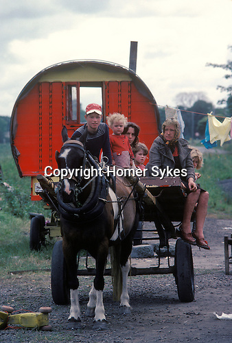 Gypsy family southern Ireland with traditional horse drawn caravan. Eire.