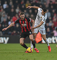 Bournemouth's Dan Gosling (left) is tackled by Wolverhampton Wanderers' Romain Saiss (right) <br /> <br /> Photographer David Horton/CameraSport<br /> <br /> The Premier League - Bournemouth v Wolverhampton Wanderers - Saturday 23 February 2019 - Vitality Stadium - Bournemouth<br /> <br /> World Copyright © 2019 CameraSport. All rights reserved. 43 Linden Ave. Countesthorpe. Leicester. England. LE8 5PG - Tel: +44 (0) 116 277 4147 - admin@camerasport.com - www.camerasport.com