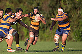 Joshua Stol tries to fend off the Patumahoe  defenders as he attacks late in the game. Counties Manukau Premier Club Rugby game between Patumahoe & Bombay, played at Patumahoe on Saturday June 18th 2016. Patumahoe won the game 27 - 15 after leading 9 - 3 at halftime. Photo by Richard Spranger.