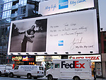 Tiger Woods with his Mother in a Billboard Ad Campaign AMEX My Life ... My Card on November 19, 2006 in Times Square, New York City.