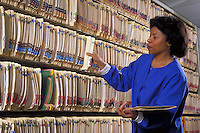 African-american nurse retrieves patient file