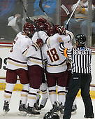 Steve Santini (BC - 6), Destry Straight (BC - 17), Michael Sit (BC - 18), Tim Benedetto - The Boston College Eagles defeated the visiting University of New Brunswick Varsity Reds 6-4 in an exhibition game on Saturday, October 4, 2014, at Kelley Rink in Conte Forum in Chestnut Hill, Massachusetts.