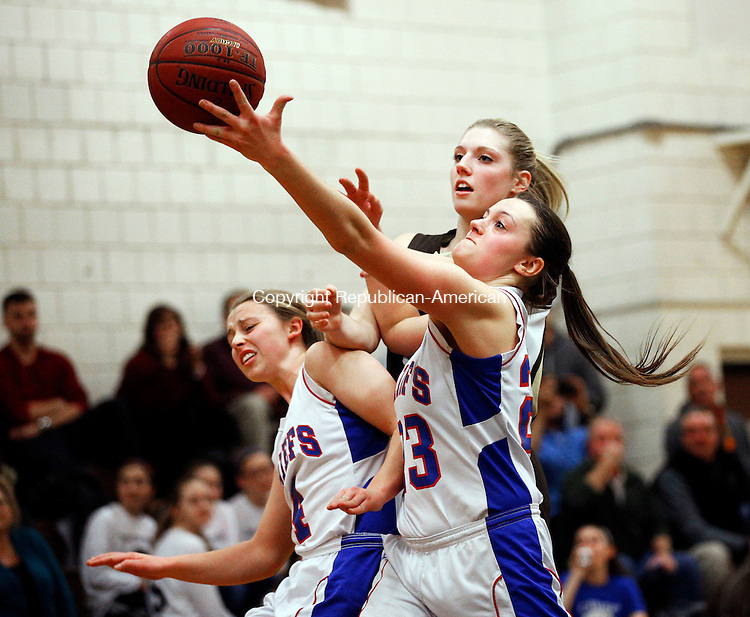 Woodbury, CT- 19 January 2016-011916CM11-  Nonnewaug's Deanna Maurice and Thomaston's Casey Carangelo (back) go after the ball during their Berkshire League matchup in Woodbury on Tuesday. Also in the play is Nonnewaug's Jennie Wingard. Thomaston would go onto win, 56-36.    Christopher Massa Republican-American