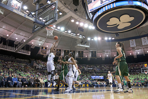A general view as Notre Dame forward Devereaux Peters (#14) goes up for a rebound in second half action of NCAA Women's basketball game between South Florida and Notre Dame.  The Notre Dame Fighting Irish defeated the South Florida Bulls 80-68 in game at Purcell Pavilion at the Joyce Center in South Bend, Indiana.