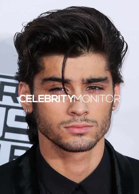 LOS ANGELES, CA, USA - NOVEMBER 23: Zayn Malik, One Direction arrives at the 2014 American Music Awards held at Nokia Theatre L.A. Live on November 23, 2014 in Los Angeles, California, United States. (Photo by Xavier Collin/Celebrity Monitor)