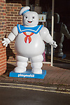 Large Playmobil Stay Puft model standing in street, Marlborough, Wiltshire, England, UK