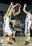 RAPID CITY, SD - FEBRUARY 24, 2016 -- Riley Ryan #32 of Black Hills State shoots between South Dakota Mines defenders Marco Pascolo #33 and Anton Almqvist #24 during their college basketball game Wednesday at the Rushmore Plaza Civic Center Ice Arena, S.D.  (Photo by Dick Carlson/Inertia)