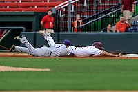 Junior first baseman Ryan Kinsella (22) of the Elon Phoenix is caught taking a lead too far off first base and is tagged out in a rundown by shortstop Hunter Burton (1) of the Furman Paladins in a first-round Southern Conference Tournament game on Wednesday, May 22, 2013, at Fluor Field at the West End in Greenville, South Carolina. Furman won, 10-1. (Tom Priddy/Four Seam Images)