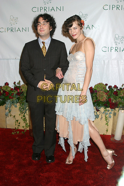 SEAN LENNON & MILLA JOVOVICH.Royal Birthday Ball for Sean P. Diddy Combs - Inside Arrivals.Cipriani's, New York City, New York .November 4, 2004.full length, light blue dress, layers, flowing, arms linked, pinstripe suit.www.capitalpictures.com.sales@capitalpictures.com.© Capital Pictures.com
