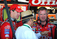Nov. 7, 2008; Avondale, AZ, USA; NASCAR Sprint Cup Series driver Carl Edwards (left) and crew chief Bob Osborne (right) talk with team owner Jack Roush during practice for the Checker Auto Parts 500 at Phoenix International Raceway. Mandatory Credit: Mark J. Rebilas-