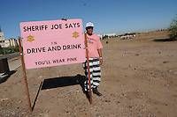 "Tempe, Arizona - Controversial Maricopa County sheriff Joe Arpaio -who bills himself as the ""toughest sheriff in America""- sent out to the streets a new chain gang made up entirely of undocumented immigrants who have been convicted of drunken driving. According to the Maricopa County Sheriff's Office (MCSO), the new chain gang attempts to send a strong message about the hazards of driving under the influence (DUI). Inmates who are part of the chain gang are immigrants living illegally in the United States. They were previously arrested for driving a vehicle under the influence of alcohol. All are serving sentences for DUI offenses committed while driving in Maricopa County. Photo by Eduardo Barraza © 2011"