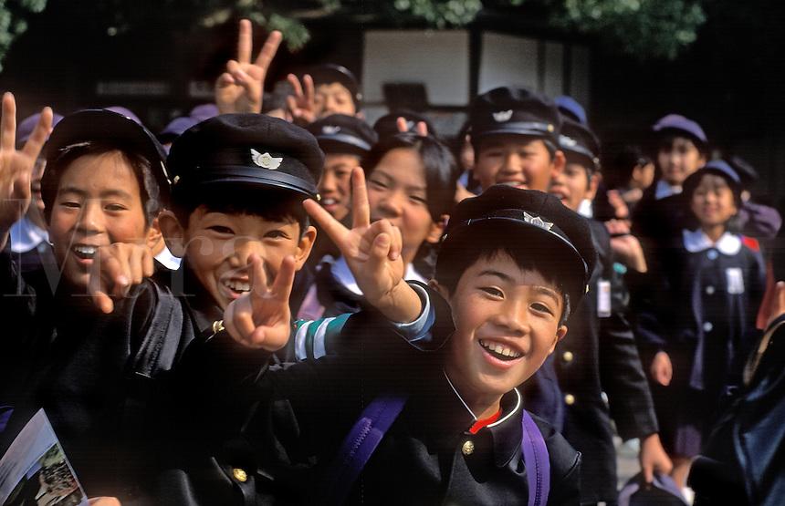 JAPANESE SCHOOL CHILDREN flash the PEACE SIGN - JAPAN