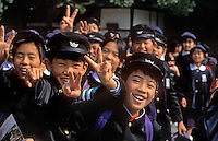 JAPANESE SCHOOL CHILDREN flash the PEACE SIGN - JAPAN