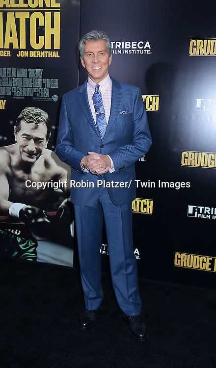 """Michael Buffer attends the World Premiere of """"Grudge Match"""" at the Ziegfeld Theatre in New Yok City on December 16, 2013."""