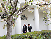 United States President Donald J. Trump and President Emmanuel Macron of France walk to the Oval Office to attend a meeting fduring a state visit to The White House in Washington, DC, April 24, 2018. Credit: Chris Kleponis / Pool via CNP