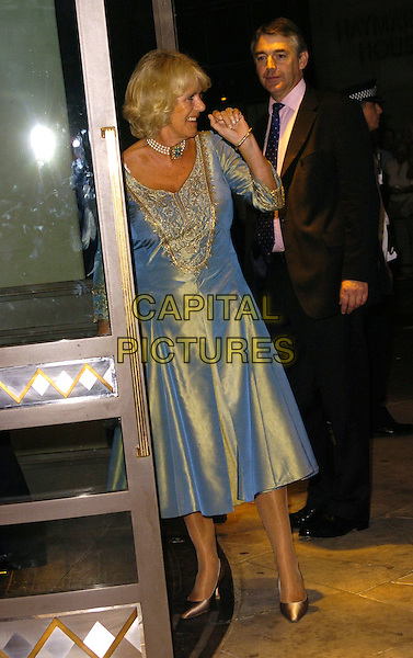 HRH CAMILLA, DUCHESS OF CORNWALL.At The Sir John Betjeman Gala,.Prince Of Wales Theatre, Coventry Street, London, .September 10th 2006..full length roayl royalty blue two tone dress gold silk satin shiny pearl choker necklace hand funny .Ref: CAN.www.capitalpictures.com.sales@capitalpictures.com.©Can Nguyen/Capital Pictures