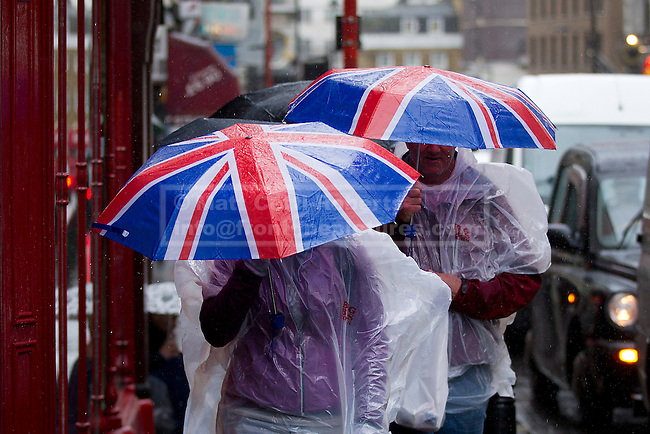 24/09/2012. LONDON, UK. Members of the public use Union Jack umbrellas and waterproof jackets in an attempt to stay dry in central London today (24/09/12). Rain and strong winds today hit the UK causing widespread disruption with gusts of up to 60mph predicted for the north of England and up to 80mm of rain predicted in some areas.. Photo credit: Matt Cetti-Roberts