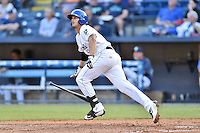 Asheville Tourists first baseman Josh Fuentes (19) runs to first during a game against the Greenville Drive at McCormick Field on May 24, 2016 in Asheville, North Carolina. The Tourists defeated the Drive 17-7. (Tony Farlow/Four Seam Images)