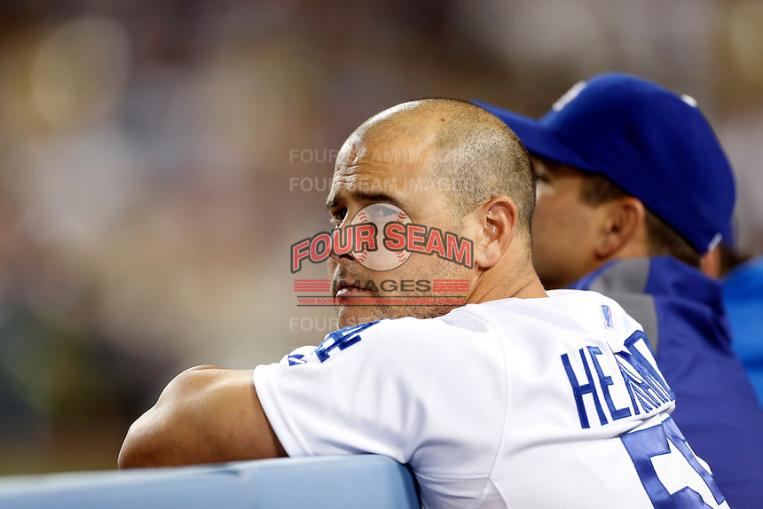 Ramon Hernandez #55 of the Los Angeles Dodgers watches a game against the Washington Nationals from the Dodgers dugout at Dodger Stadium on May 13, 2013 in Los Angeles, California. (Larry Goren/Four Seam Images)