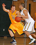 SPEARFISH, SD - JANUARY 5, 2013:  Joey Mitchell #5 of Black Hills State drives toward Fort Lewis College defender Matthias Weissl #12 during their Rocky Mountain Athletic Conference basketball game Saturday at the Young Center in Spearfish, S.D.  (Photo by Richard Carlson/dakotapress.org)