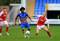 Kyle Dempsey of Fleetwood Town battes for the ball against Junior Brown of Shrewsbury Town during the Sky Bet League 1 match between Shrewsbury Town and Fleetwood Town at Greenhous Meadow, Shrewsbury, England on 21 October 2017. Photo by Leila Coker / PRiME Media Images.
