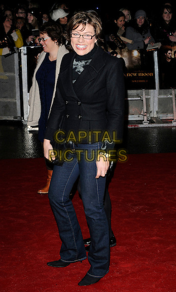 "KATE SILVERTON.Attending ""The Twilight Saga: New Moon"" Fan Event at the Battersea Evolution, London, England, UK, November 11th 2009..full length black coat glasses jacket pea denim jeans clutch bag smiling polo neck top .CAP/CAN.©Can Nguyen/Capital Pictures."