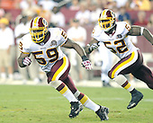 Landover, MD - August 25, 2007 --  Washington Redskins linebackers London Fletcher (59) and Rocky McIntosh (52) pursue a ball carrier in first half action against the Baltimore Ravens at FedEx Field in Landover, Maryland on Saturday, August 25, 2007..Credit: Ron Sachs / CNP