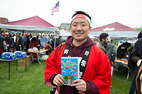 International Fiesta 2018, on the Drill Field. Kei Mamiya of the HCDC hands out programs.<br />  (photo by Megan Bean / &copy; Mississippi State University)