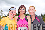 Duagh runners Sam McElligott, Helena Sheehy and Paula Watson pictured last Sunday in Knocknagoshel for the 5K as part of the annual Harvest Festival.