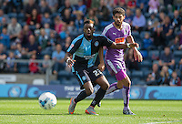Gozie Ugwu of Wycombe Wanderers  & Kelvin Mellor of Plymouth Argyle keep eyes on the ball during the Sky Bet League 2 match between Wycombe Wanderers and Plymouth Argyle at Adams Park, High Wycombe, England on 12 September 2015. Photo by Andy Rowland.