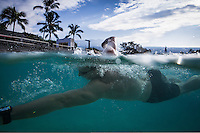 An age group athlete gets in a practice swim before the 2013 Ironman World Championship in Kailua-Kona, Hawaii on October 12, 2013.