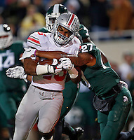 Michigan State Spartans safety Kurtis Drummond (27) takes down Ohio State Buckeyes running back Ezekiel Elliott (15) on a rush during the 1st quarter at Spartan Stadium in East Lansing, Michigan on November 8, 2014.  (Dispatch photo by Kyle Robertson)