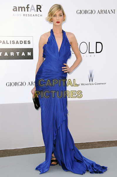 EVA RICCOBONO.arrivals at amfAR's Cinema Against AIDS 2010 benefit gala at the Hotel du Cap, Antibes, Cannes, France during the Cannes Film Festival.20th May 2010.amfar full length cobalt blue long maxi dress hand on hip ruched halterneck black clutch bag .CAP/CAS.©Bob Cass/Capital Pictures.