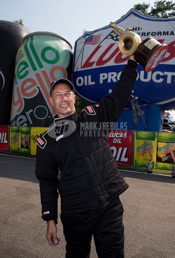 Aug. 18, 2013; Brainerd, MN, USA: NHRA top alcohol dragster driver Gord Gingles celebrates after winning the Lucas Oil Nationals at Brainerd International Raceway. Mandatory Credit: Mark J. Rebilas-
