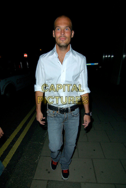 FREDDIE LJUNGBERG.The Adee Phelan product launch party, Embassy Club London, England..August 9th, 2007.full length jeans denim white shirt stubble facial hair black belt .CAP/CAN.©Can Nguyen/Capital Pictures