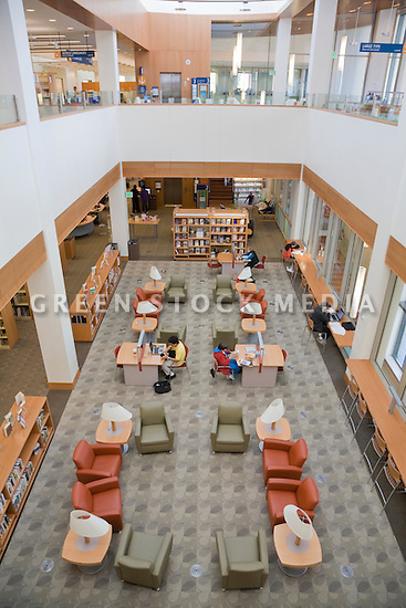 A high angle view of a open floor plan library flooded with natural light. The San Mateo Public Library integrates significant green building practices and achieved LEED Silver certification. Green features include extensive daylighting, efficient underfloor air supply, venting windows, low VOC materials, native plant landscaping, and much more. San Mateo, California, USA