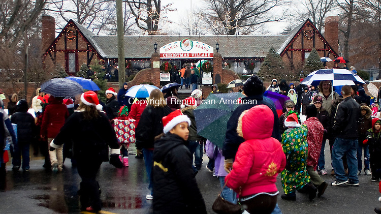 TORRINGTON, CT - 13 DECEMBER 2009 -121309JT07--<br /> People flock to the Christmas Village following Sunday's parade through downtown Torrington in freezing rain. Sunday marked the grand opening of Christmas Village's 62nd consecutive year.<br /> Josalee Thrift Republican-American