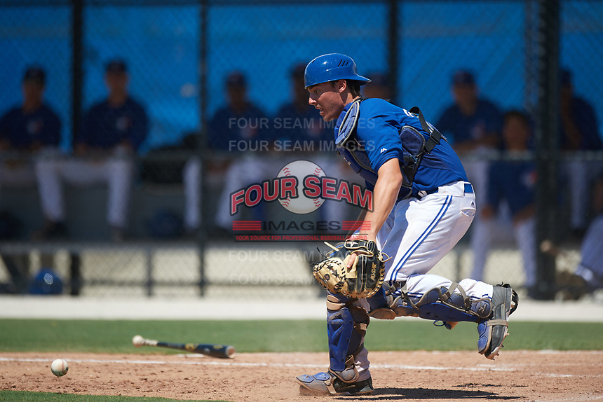 GCL Blue Jays catcher Hagen Danner (33) fields a bunt during a game against the GCL Pirates on July 20, 2017 at Bobby Mattick Training Center at Englebert Complex in Dunedin, Florida.  GCL Pirates defeated the GCL Blue Jays 11-6 in eleven innings.  (Mike Janes/Four Seam Images)