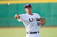 Corey Seager #48 of the USA 18u National Team throws in the outfield prior to the game against the USA Baseball Collegiate National Team at the USA Baseball National Training Center on July 2, 2011 in Cary, North Carolina.  The College National Team defeated the 18u team 8-1.  Brian Westerholt / Four Seam Images