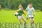 Skellig's Brian O'Sullivan holds of the challenge of Finuge's Michael Stackpoole in Finuge on Sunday.
