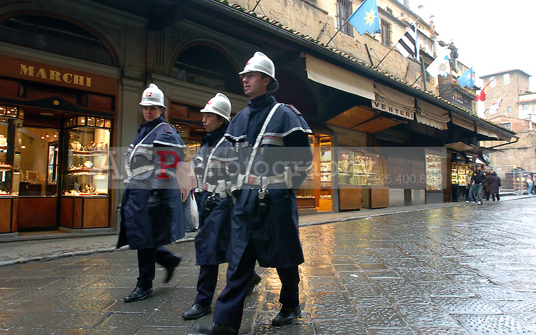 Police walk across a bridge  in Florence, Italy March 1, 2006. (Photo by Alan Greth)