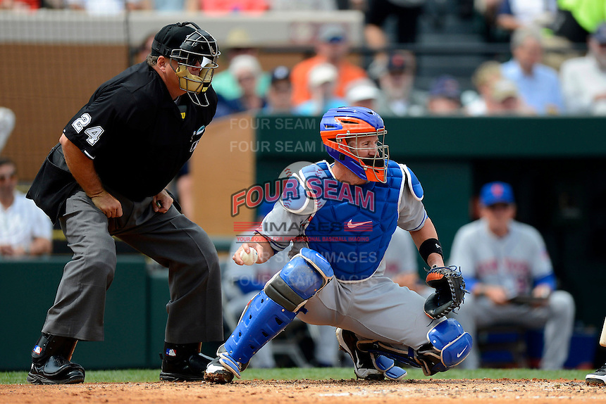 New York Mets catcher John Buck #44 and umpire Jerry Layne during a Spring Training game against the Detroit Tigers at Joker Marchant Stadium on March 11, 2013 in Lakeland, Florida.  New York defeated Detroit 11-0.  (Mike Janes/Four Seam Images)