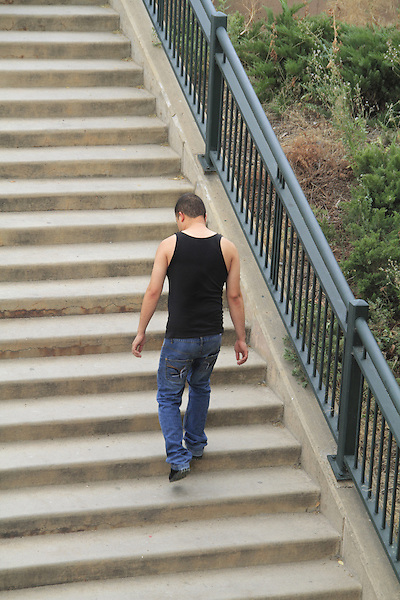 Man walks upstairs in Denver, Colorado. .  John offers private photo tours in Denver, Boulder and throughout Colorado. Year-round Colorado photo tours.