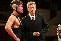 27 February 2006: Stanford's Kevin Klemm with Tanner Gardner during the  125 lbs. Pac-10 Wrestling Championships at Maples Pavilion in Stanford, CA.