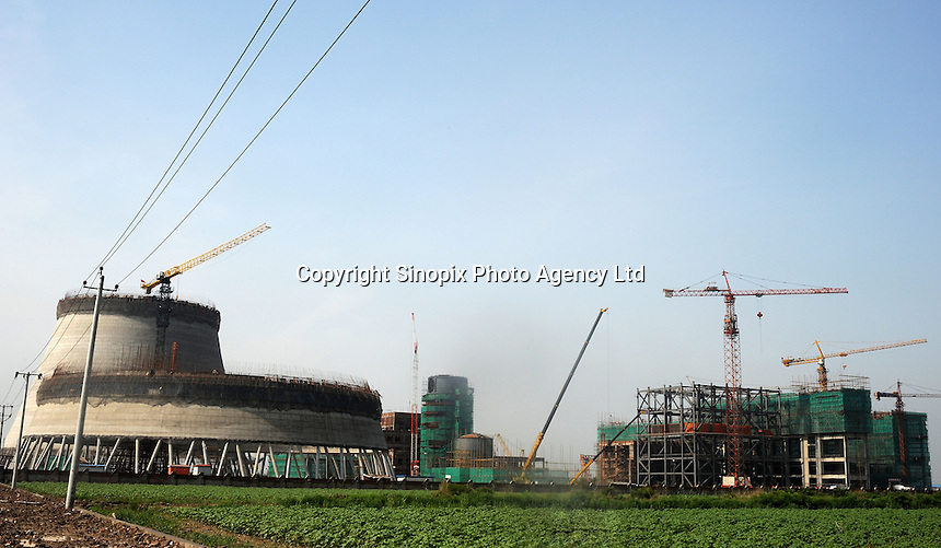 The cooling towers of a power coal-fired station are constructed outside Tinjin in China. China is the biggest consumer of coal and the biggest contributor to green-house gasses. It is estimated a new coal power station opens each week..