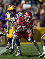NWA Democrat-Gazette/BEN GOFF @NWABENGOFF<br /> Jonathan Nance, Arkansas wide receiver, evades LSU defenders after a catch in the third quarter Saturday, Nov. 11, 2017 at Tiger Stadium in Baton Rouge, La.