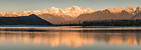 Sunset over Southern Alps, Mount Tasman and Mount Cook with reflections in Cook River in foreground, Westland National Park, World Heritage Area, West Coast, New Zealand